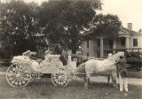 Miss Carrie Fry, queen of the Barbour County Fair, and her pages in a decorated horse-drawn...