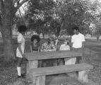 Students from Goodwyn Junior High School in Montgomery, Alabama, seated at a picnic table.