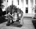 Students from Goodwyn Junior High School with a replica of the Liberty Bell in front of the...