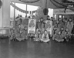 Boy Scouts holding calenders at Grimes Motor Company, on the southwest corner of Bell and...