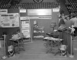 Grover Business Machines booth at Garrett Coliseum during the 1956 South Alabama Fair in...