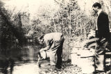 """Planting bream and bass in Limestone Creek, near Monroeville."""