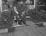 Man seated in a garden display in a booth at Garrett Coliseum during the South Alabama Fair in...
