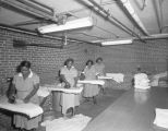 Employees ironing at the Montgomery Tuberculosis Sanatorium at 2140 Upper Wetumpka Road in...