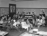 Students with a diorama of an orchestra in a classroom at Bellinger Hill School at 1153 South...
