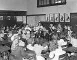 Students playing stringed instruments in a classroom at Cloverdale School at 1125 East Fairview...