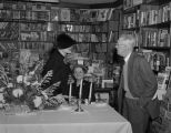Lella Warren at a reception in the book department of A. Nachman, Inc., at 100 Dexter Avenue in...