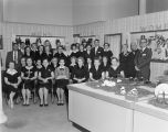 J. C. Penney Company employees with Mr. Penney in the shoe department at 27 Court Square in...