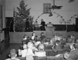 Child receiving a Christmas gift at the Salvation Army Citadel at 308 North Lawrence Street in...