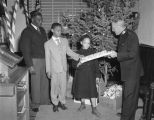 African American children receiving Christmas gifts at the Salvation Army Citadel at 308 North...