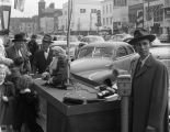 Members of the Exchange Club at a Salvation Army Christmas donation display on Dexter Avenue in...