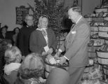 Woman receiving a basket of food from the Salvation Army at the Citadel at 308 North Lawrence...