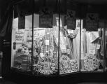 Window display of fabric and sewing supplies at the Silver's store at 71-73 Dexter Avenue in...