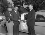 Southern Bell representative with a highway patrol officer and Floyd Mann, promoting a...