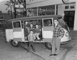 Children in a Volkswagen van in front of Southern Motor Imports at 501 Montgomery Street in...