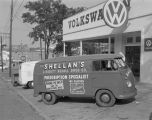 Shellan's Liggett Rexall Drug Company van parked in front of Southern Motor Imports at 501...