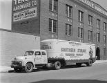 Southern Storage Warehouse Company truck parked in front of Teague Hardware Company warehouse at...