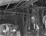 Employees operating the forge at the Standard Forge and Axle Company in Montgomery, Alabama.