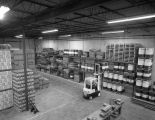 Boxes and barrels of Quaker State motor oil in the warehouse of the Upchurch Oil and Supply...