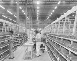 Employees in the warehouse at the Western Electric material management center on the Selma Highway...