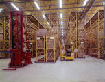 Employee driving a forklift in the warehouse at the Western Electric material management center on...