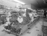 Floral display in front of the dining counter at the F. W. Woolworth Company in the Normandale...