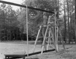 Boys repairing the baseball backstop, probably at Camp Rotary in Elmore County, Alabama.