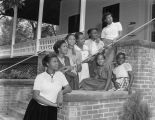 Young African American women on the porch of the Community House at 409 South Union Street in...