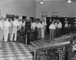 Men from Alabama Power Company visiting one of the hydroelectric power dams in the state.