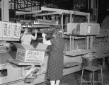 Women packing Mason jars at the Hazel-Atlas Glass division of the Continental Can Company on Lower...