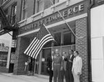 Flag raising outside the Montgomery Area Chamber of Commerce at 41 Commerce Street in downtown...