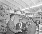 Manager of the Big Zollie's store at 618 Mobile Street in Montgomery, Alabama, receiving an...