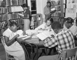 African American teenagers studying in the library of the Community House at 409 South Union...