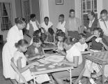African American teenagers playing games at the Community House at 409 South Union Street in...
