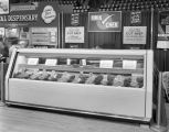Meat display in the Kwik Chek booth at Garrett Coliseum during the 1956 South Alabama Fair in...