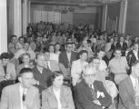 Audience at an election returns broadcast sponsored by the Montgomery Radio Network Association,...