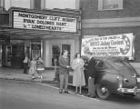 Winner of the WAPX Jalopy Contest with the prize car outside the Empire Theatre at 234 Montgomery...