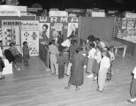 Booth for radio station WRMA at Garrett Coliseum during the 1955 South Alabama Fair in Montgomery,...