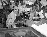 Disc jockey from radio station WRMA in Montgomery, Alabama, playing records at Dozier's Radio...