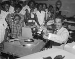 "Marius J. ""Ace"" Anderson from radio station WRMA in Montgomery, Alabama, playing records..."