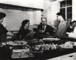Governor Gordon Persons with Lottie Graham, Vernon Merritt and Laura Croom Rivers in the kitchen...