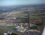 Aerial view of the shopping center and apartments at the intersection of Eastern Boulevard and...