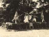 Seven girls posing in their costumes for a May Day celebration at Fairmont School in Alabama.