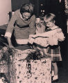 Governor Lurleen Wallace helping daughter, Lee open a birthday present.