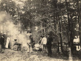 African American men stirring pots of camp stew at the dedication of the school building in Pine...