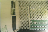Lattice on the well porch of the Paul and Ada Cook Burns House at 102 Shade Road in Pushmataha,...