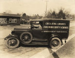 "Man driving a vehicle in Cullman County, Alabama, that reads, ""Circulating Libraries, Cullman..."