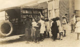 Children selecting books from the Jefferson County Free Library bookmobile in Jefferson County,...