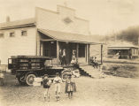 Two boys and a girl in front of the Jefferson County Free Library bookmobile in Jefferson County,...