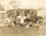 Children reading books at the Durham Public Library bookmobile in Durham, North Carolina.